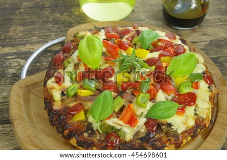 round  finished pizza witch basil and rosemary - stock photo