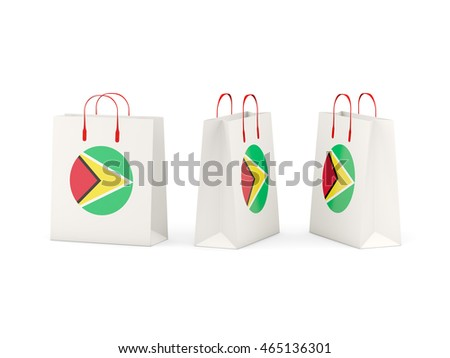 Round flag of guyana on shopping bags. 3D illustration