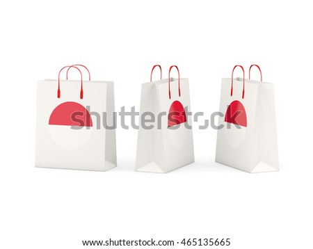 Round flag of monaco on shopping bags. 3D illustration