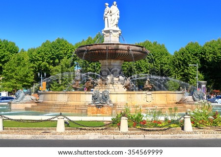Round fountain decorates a square in Aix en Provence, Languedoc Roussillon, France - stock photo