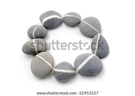Round frame for natural grey stones - stock photo
