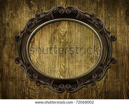 round frame on on wooden background - stock photo