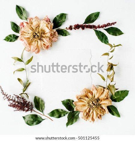 round frame wreath pattern with beige dried peonies flowers, branches, leaves and paper blank isolated on white background. flat lay, top view, mock up