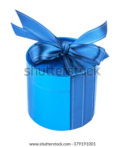 Round gift box, tied with a blue ribbon with a bow on top. Blue pearl color. Isolated on white background. - stock photo