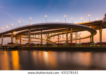 Round highway intersection cross connect, waterfront during twilight, Bangkok Thailand - stock photo