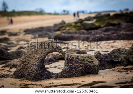 Round hole in a beach stone - stock photo