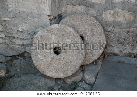Round Mill Stone - stock photo