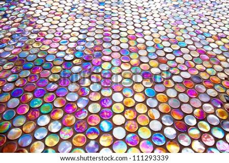 Round nacreous purple glass mosaic tile pattern - stock photo
