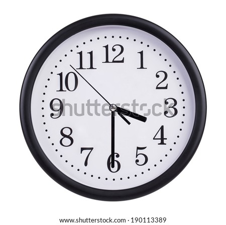 Round office clock shows half of the fourth