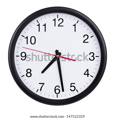 Round office wall clock shows half past - stock photo