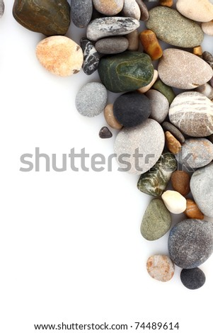 Round pebble stones isolated on white - stock photo