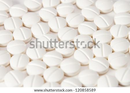 round pills paracetamol or aspirin painkiller remedy - stock photo