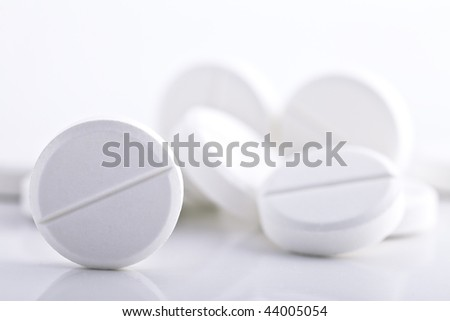 round pills with low DOF - stock photo