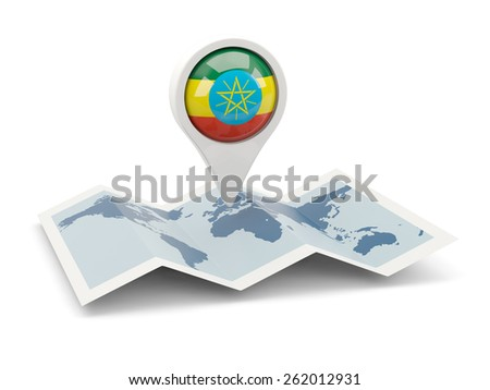 Round pin with flag of ethiopia on the map - stock photo