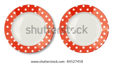 Round plate with red border isolated on white with clipping path included - stock photo