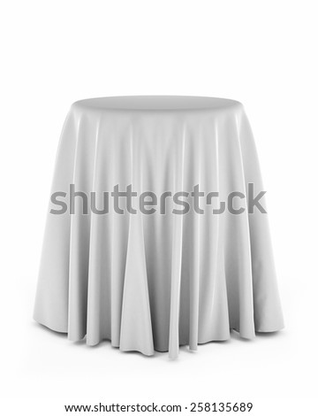 Round presentation pedestal covered with a white cloth over white background - stock photo