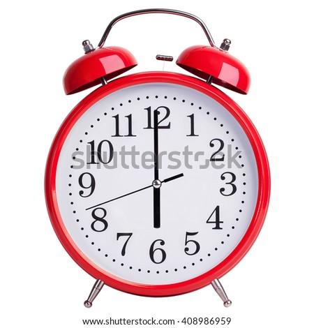 Round red alarm clock shows exactly sixl - stock photo
