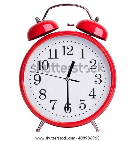 Round red alarm clock shows half of the first - stock photo