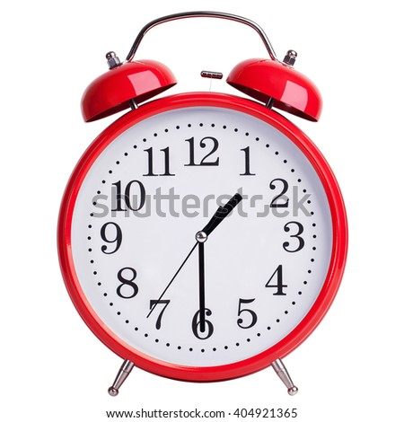 Round red alarm clock shows half of the second - stock photo