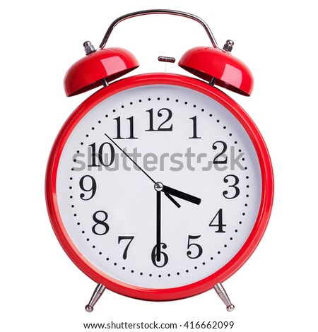Round red alarm clock shows half past three - stock photo