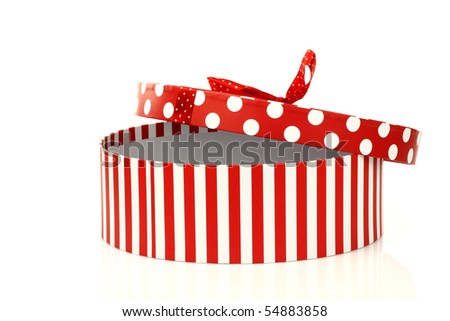 round red and white gift box on a white background - stock photo