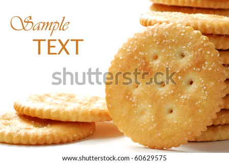 Round salty crackers on white background with copy space.  Macro with shallow dof. - stock photo