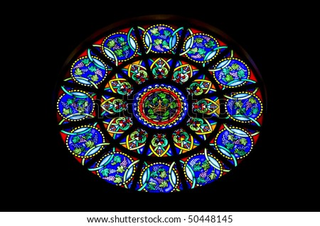 Round stain glass window known as a rose window - stock photo