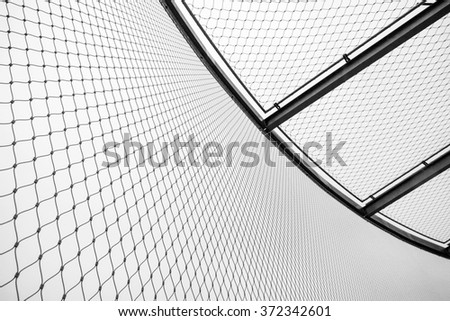 Round steel chain link fence and ceiling, restricted area border - stock photo