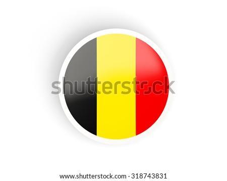 Round sticker with flag of belgium isolated on white - stock photo
