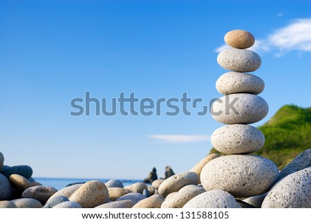 Round stones for meditation laying on seacoast - stock photo