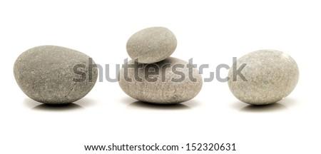 round stones isolated on white - stock photo