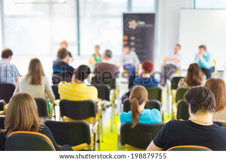 Round table discussion at Business convention and Presentation. Audience at the conference hall. - stock photo