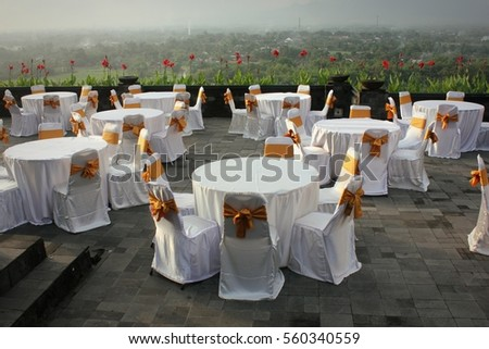 round tables and chairs in a wedding reception