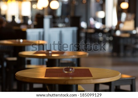 Round tables in the interior of the restaurant - stock photo