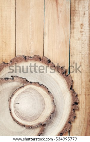 Round three boards on old wooden table
