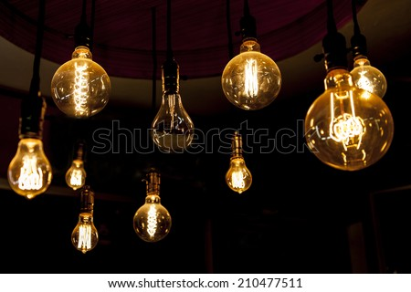 round tungsten lamps, the difference, blind spot, bad finger, mutation, black sheep - stock photo