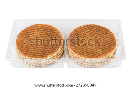 Round waffles in plastic transparent box isolated on white background - stock photo
