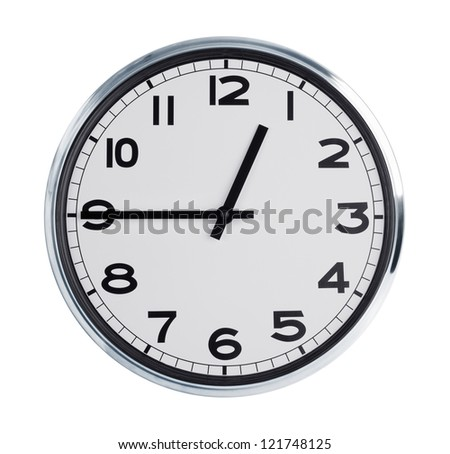 Round wall clock is a quarter hour - stock photo