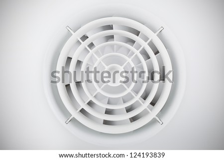 Round white plastic grille with air fan - stock photo