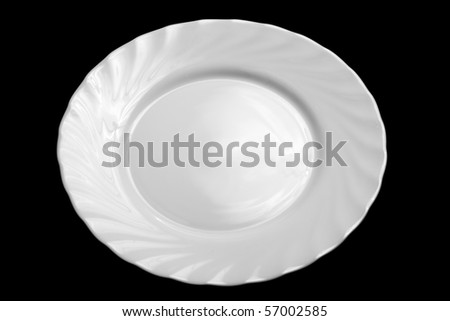 Round white plate isolated on black background - stock photo