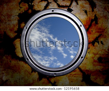 Round window in prison, cloudy sky - stock photo