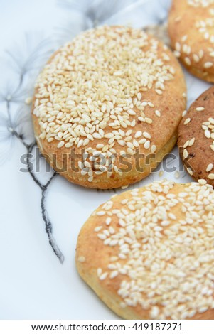 Round yellow cookies with sesame closeup background - stock photo