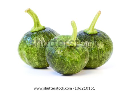 Round zucchini on a white background