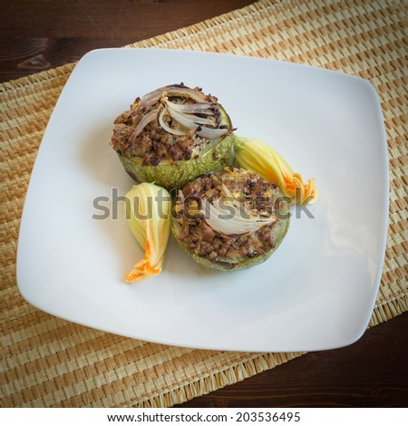 Round zucchini stuffed with minced meat, italian cuisine