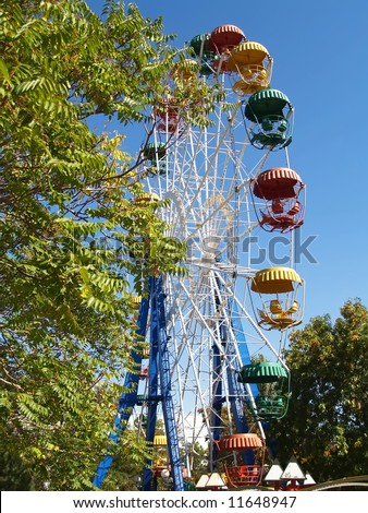 Roundabout big wheel in summer park - stock photo