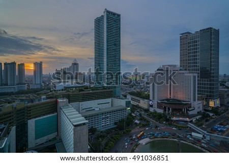 Roundabout Hotel Indonesia, Jakarta, Indonesia - September 28, 2016 : Sunset in Jakarta taken from the rooftop of the Mandarin Oriental hotel