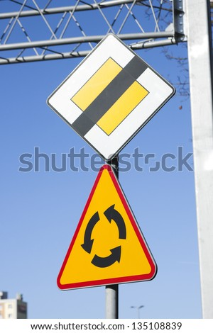 Roundabout road sign, the end of the priority - stock photo