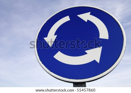 roundabout signal with blue and cloudy sky - stock photo