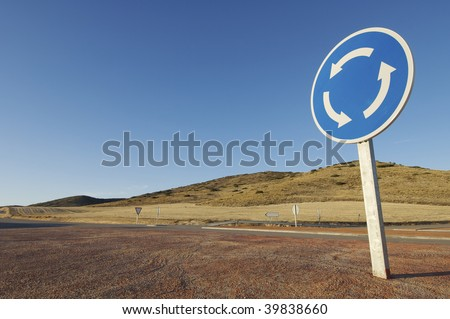 roundabout signal with blue sky - stock photo