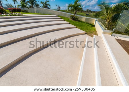 Rounded concrete stairs, staircase. - stock photo